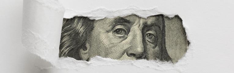 dollar bill peaking through