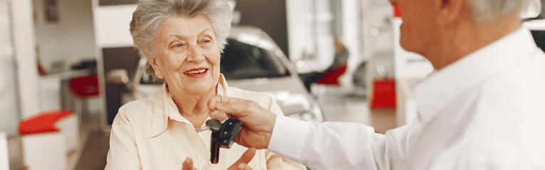 older woman getting car keys