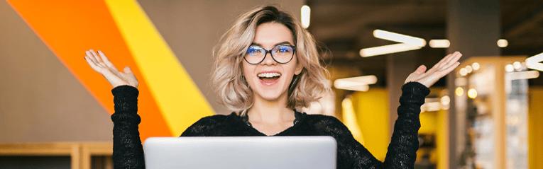 woman on laptop smiling