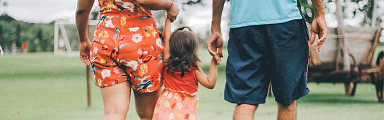 couple holding their childs hand as they think about when to start saving for retirement