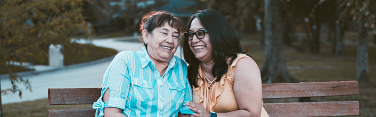 woman and her mother laughing together