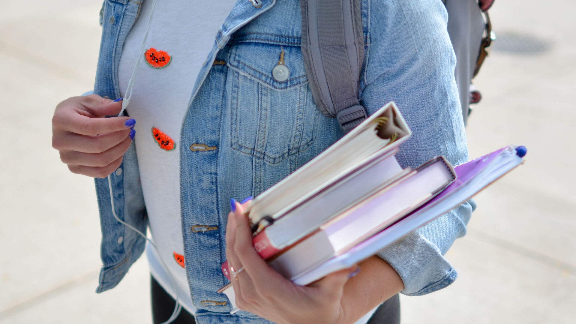 college woman carrying books