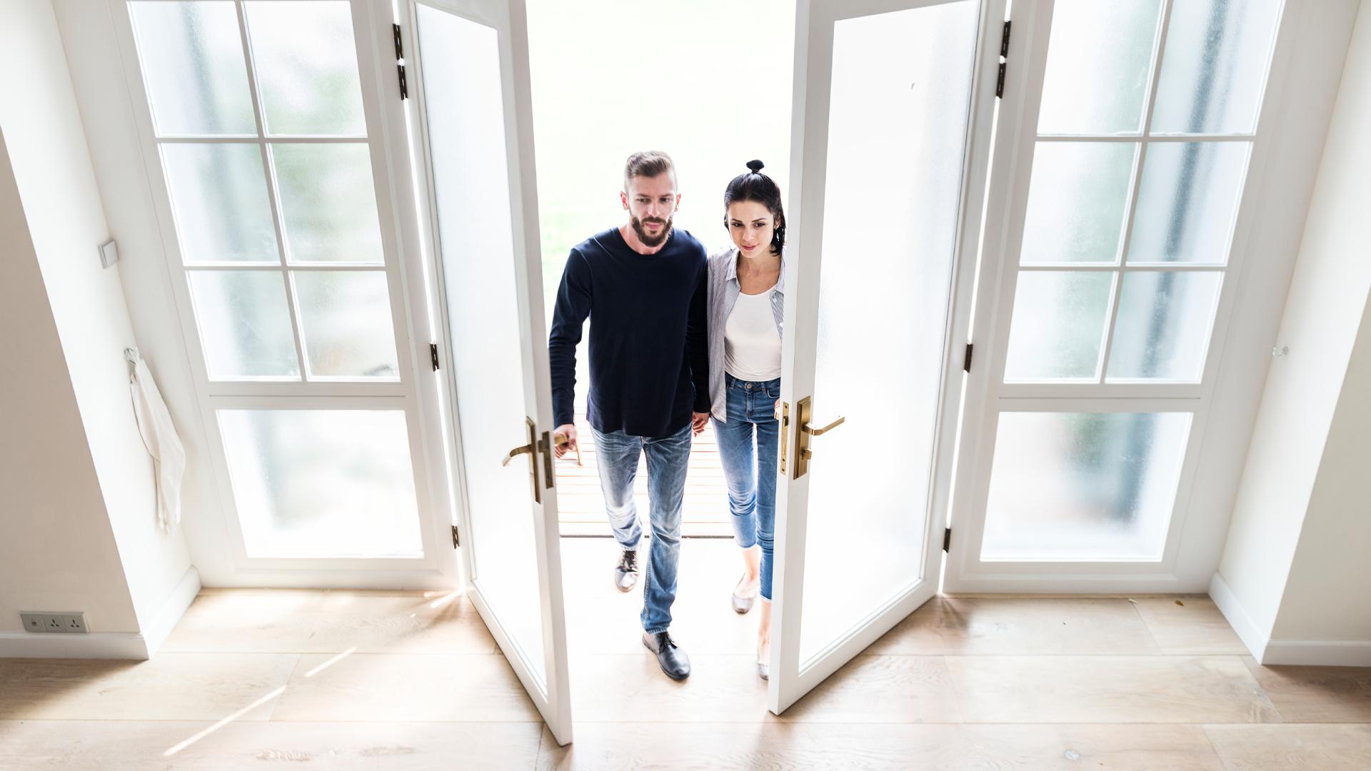 couple entering empty house
